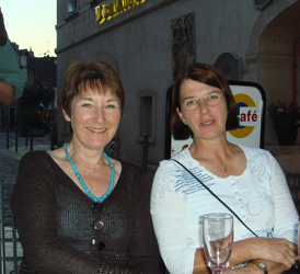 Two women at a pavement bar